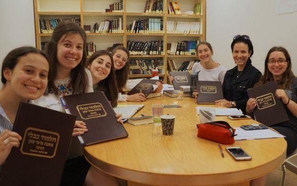 Seven students (l-r), Davina Goodman, North America; Moriah Fink, Europe, Natalie Maurer, Europe; Abby Bessler, North America; Ella New, Australia; Navit Tzadik, Asia; Sarah Kopyto, North America, celebrated their completion of Talmud Tractate Chagigah.